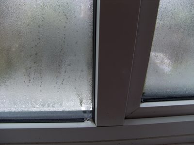 condensation on double-glazed window internal and inside sealed unit