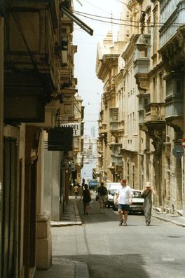 Malta Valletta view to harbour old tan colour limestone buildings pedestrians tweaked 1 DHD